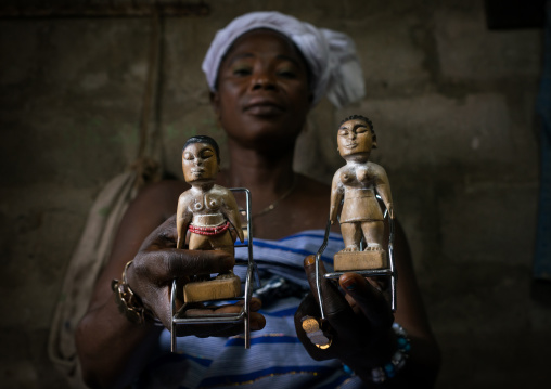 Benin, West Africa, Bopa, miss hounyoga with the wooden figures of her dead twins zinsou the boy and zinhoue the girl