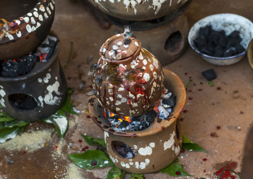 Benin, West Africa, Bonhicon, chicken cooked in a pot during a voodoo ceremony