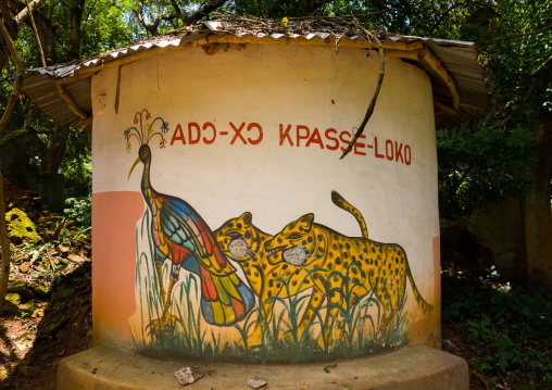 Benin, West Africa, Ouidah, temple in the sacred forest of kpasse painted wall