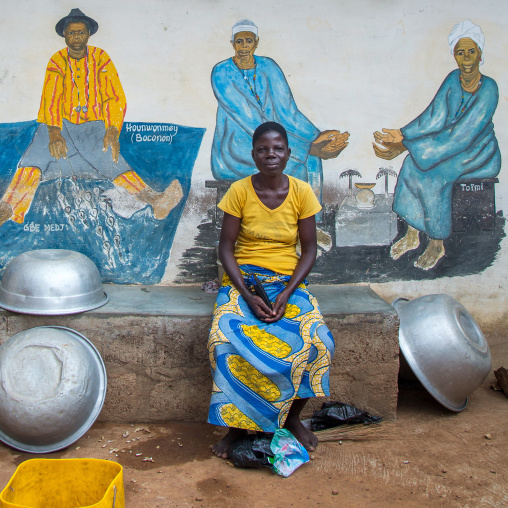 Benin, West Africa, Savalou, a priestess from the voodoo covent of the royal palace in front of a painted wall