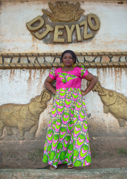Benin, West Africa, Savalou, woman pausing in front of a king palace
