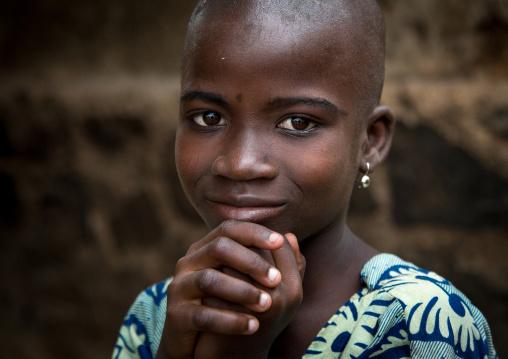 Benin, West Africa, Savalou, shy and shaved beautiful beninese girl