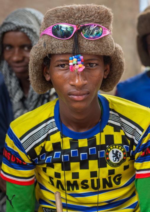 Benin, West Africa, Copargo, young fulani peul tribe man with colorful and fashionable clothes