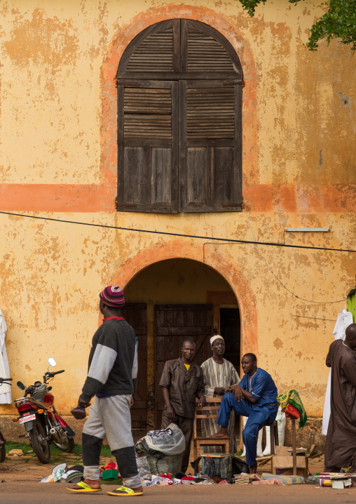 Benin, West Africa, Copargo, men in front of an old colonial house