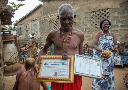 Benin, West Africa, Bopa, dah tofa voodoo master showing his diplomas