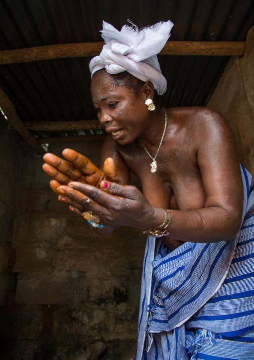 Benin, West Africa, Bopa, mrs hounyoga prays the twins spirits in the dan temple