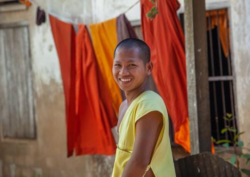 Young smiling monk in a monastery, Battambang province, Battambang, Cambodia