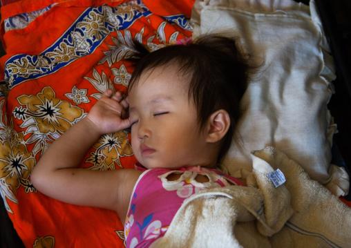 Cambodian baby sleeping on his back, Phnom Penh province, Phnom Penh, Cambodia