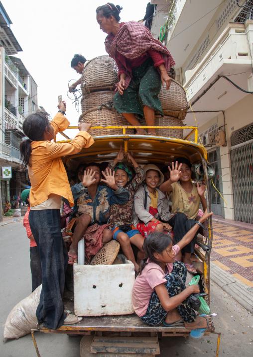 Rickshaw overloaded in the street, Phnom Penh province, Phnom Penh, Cambodia