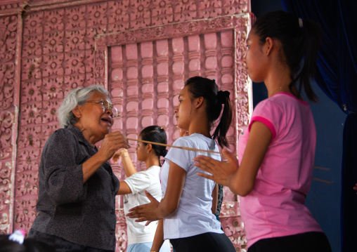 Cambodian dancers with their teacher during a training session of the National ballet, Phnom Penh province, Phnom Penh, Cambodia