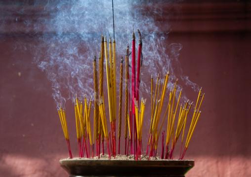 Incense sticks burning, Phnom Penh province, Phnom Penh, Cambodia
