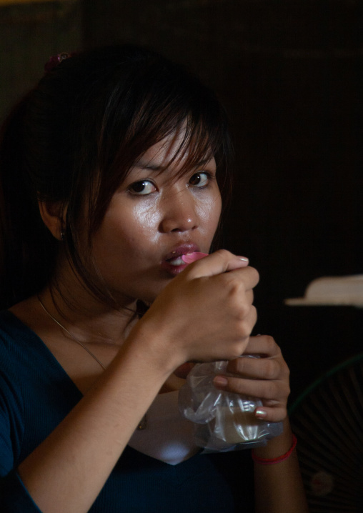 Portrait of a cambodian woman eating food, Phnom Penh province, Phnom Penh, Cambodia