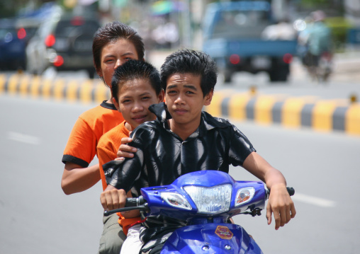 A group of children going on a motorcycle ride, Phnom Penh province, Phnom Penh, Cambodia