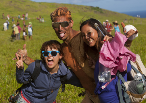 Japanese Tourists Pausing With A Rapanui Man After His Banana  Haka Pei Competition, Easter Island, Chile