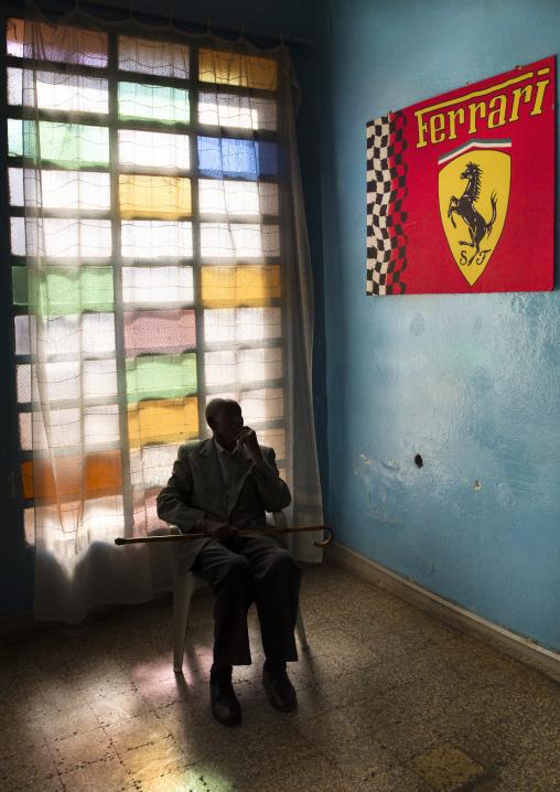 Old Man In Front Of Ferrari Poster In Asmara Swimming Pool, Eritrea