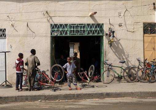 Eritrean children repairing bicycles in a shop, Semien-Keih-Bahri, Keren, Eritrea