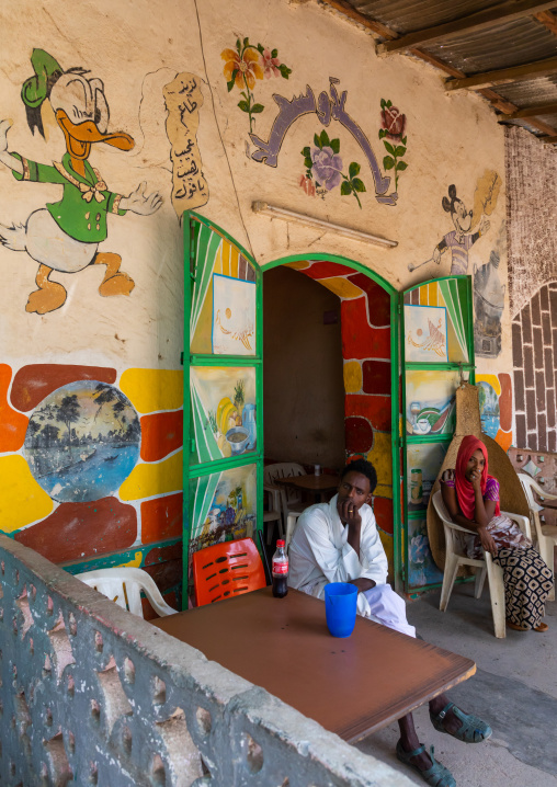 Eritrean people in a bar decorated with disney characters, Gash-Barka, Agordat, Eritrea