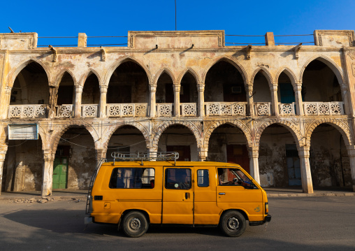 Taxi passing in front of an ottoman architecture building, Northern Red Sea, Massawa, Eritrea