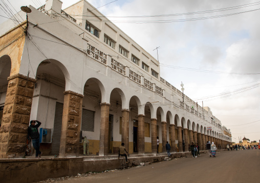 Old art deco style building with arches from the italian colonial times, Central region, Asmara, Eritrea