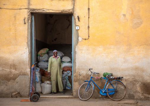 Eritrean man in front of a grain warehouse, Central region, Asmara, Eritrea