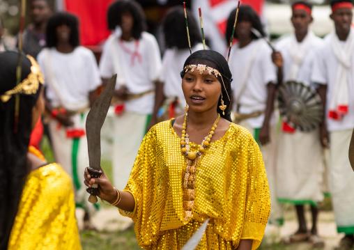 Afar tribe woman dancing with a jile knife during expo festival, Central region, Asmara, Eritrea