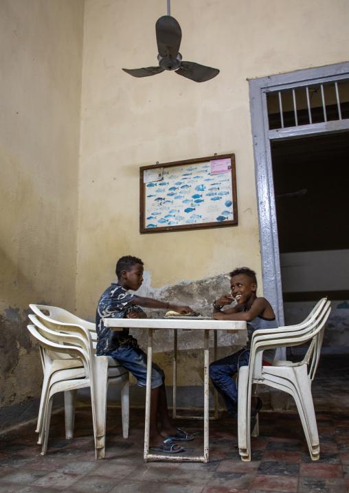 Children eating fish in selam restaurant, Northern Red Sea, Massawa, Eritrea