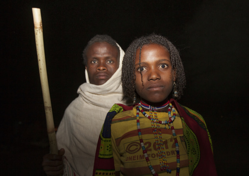 Night Shot Of A Karrayyu Tribe Man And Girl With Stranded Hair During Gadaaa Ceremony, Metahara, Ethiopia