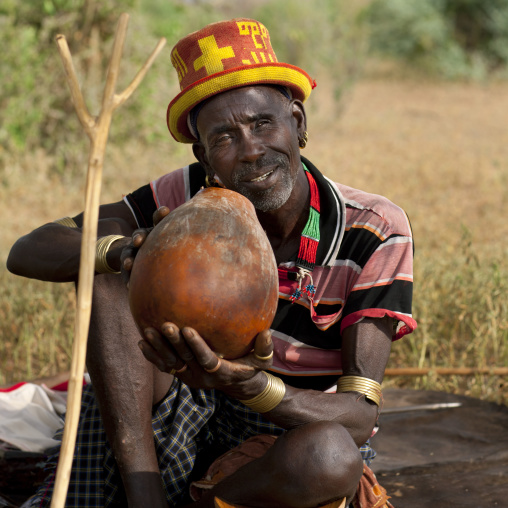 Senior Banna Man With Original Hat On And Calabash In The Hand Ethiopia
