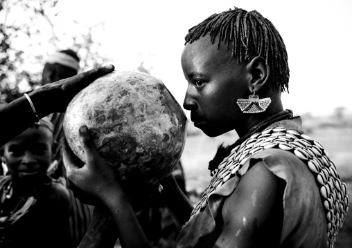 Banna Woman Drinking From Calabash During Bull Jumping Ceremony Ethiopia