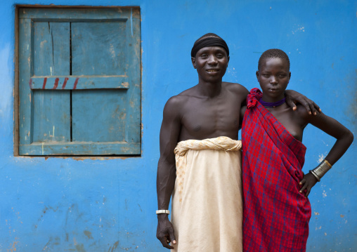 Bodi Couple Man And Woman Posing With  Loincloth Outside Blue House Ethiopia
