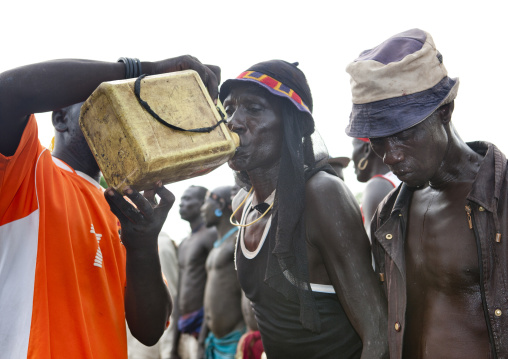 Bodi Man Drinking Alcohol From Yellow Jerrican Kael New Year Ceremony Omo Valley Ethiopia