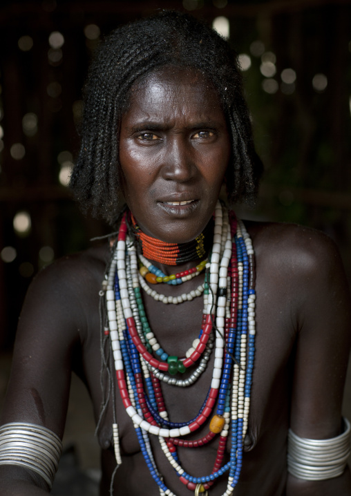Portrait Of Beautiful Erbore Tribe Woman Wearing Beaded Necklace,  Omo Valley, Ethiopia