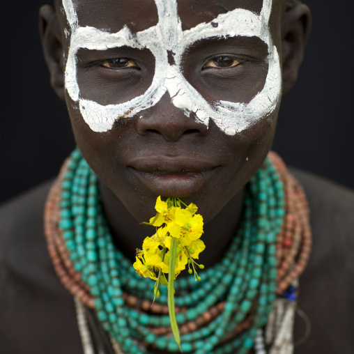 Portrait Of Karo Woman With Painted Face And Flower Ethiopia