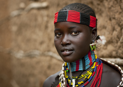 Portrait Of Hamer Beautiful Teenage Girl Posing In Front Of Clay House  Omo Valley Ethiopia