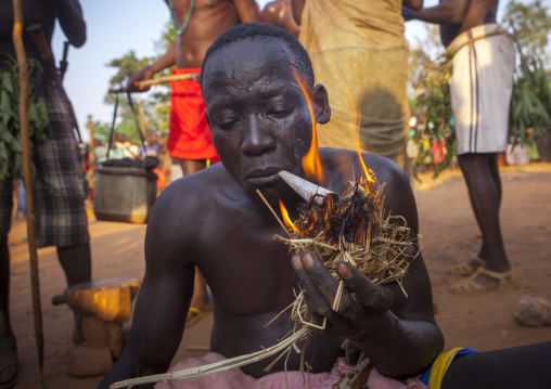 Majang Tribe Man Smoking For A Celebration, Kobown, Ethiopia