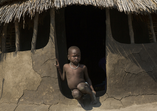 Nuer Tribe Little Boy At The Entrance Of His Hut, Gambela, Ethiopia
