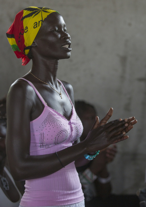 Woman Praying During Catholic Sunday Church Service, Gambela, Ethiopia