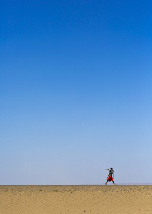 Afar Tribe Man Walking Alone In The Desert, Assayta, Ethiopia