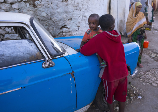 Children In Front Of An Old Peugeot 404, Harar, Ethiopia