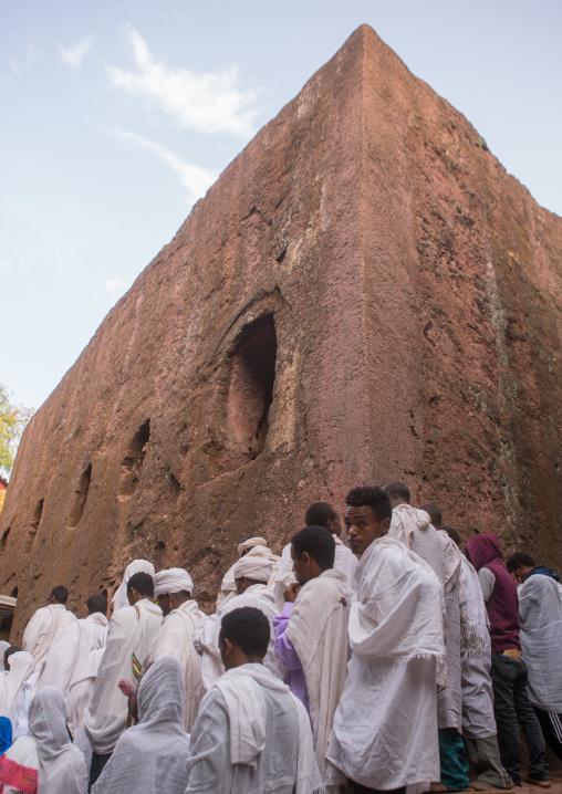 Pilgrims in front of a rock church during kidane mehret orthodox celebration, Amhara region, Lalibela, Ethiopia