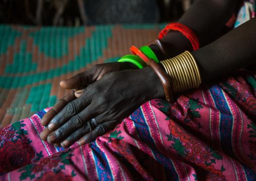 Toposa tribe woman bracelets, Omo valley, Kangate, Ethiopia