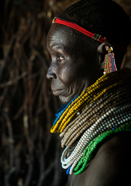 Nyangatom tribe woman with piles of beads, Omo valley, Kangate, Ethiopia