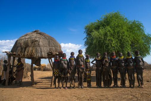 Nyangatom tribe women in a line, Omo valley, Kangate, Ethiopia