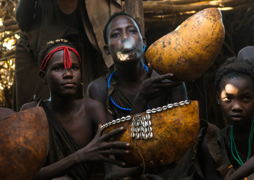 Circumcised boys from the dassanech tribe spitting to bless the visitors, Omo valley, Omorate, Ethiopia