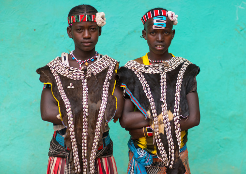 Tsemay tribe girls with traditional goat skin clothes, Omo valley, Key afer, Ethiopia