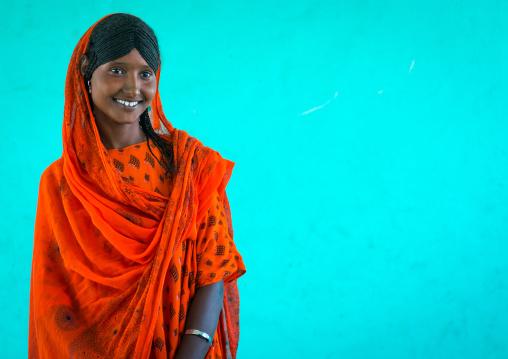 Portrait of an afar tribe girl with braided hair and sharpened teeth, Afar region, Semera, Ethiopia
