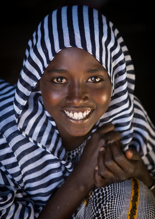 Portrait of a smiling afar tribe teenage girl, Afar region, Afambo, Ethiopia
