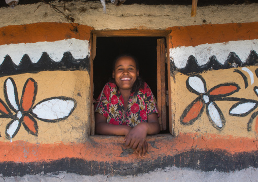 Ethiopia, Kembata, Alaba Kuito, ethiopian woman standing in the window of her traditional painted house