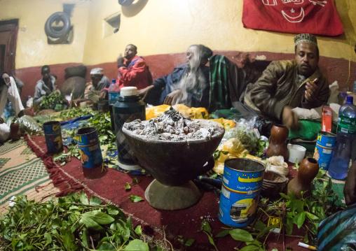 Ethiopian people chewing khat during a sufi ceremony lead by Amir Redwan in Ummi Tahir Nabigar, Harari Region, Harar, Ethiopia