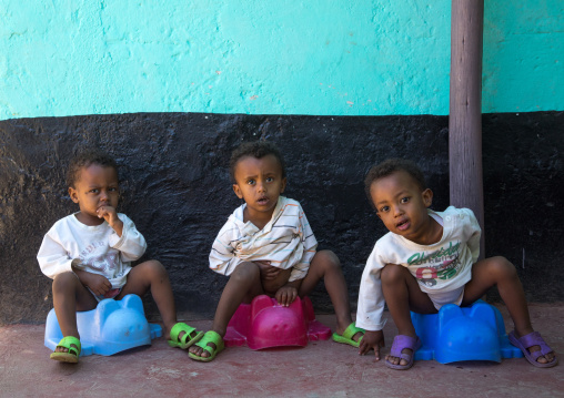Ethiopian triplets on the potty, Harari Region, Harar, Ethiopia